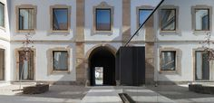 DepA has transformed an palace in Pinhel, Portugal into a cultural centre and added a mirrored glass box in its central courtyard to house a ticket office (+ slideshow). Office Building Architecture, Bamboo Architecture, Contemporary Architecture, Art And Architecture, Dezeen Architecture, Concrete Houses, Adaptive Reuse, Restaurant, Prefab