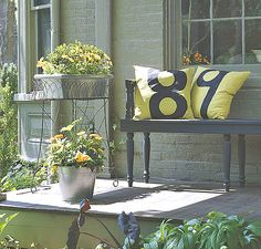 Pretty porch - love the colour combo, love the metal plant stand/containers, and LOVE the house numbers stencilled onto the pillows!!  It's all good!!