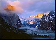 View with fog in valley and peaks lighted by sunset, winter. Yosemite National Park ( color)