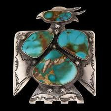 Antique sterling silver and turquoise Navajo Thunderbird brooch.