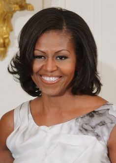 Mrs. Obama's signature bob always looks stunning and we especially love the flipped curls she added.