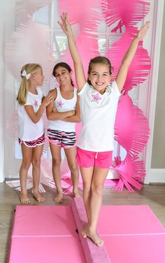 A Glam Girlie Gymnastics Birthday Party with trophy favors, gold medal cookies, edible rose bouquet, ribbon banners, DIY fondant stars cake, gymnastics competition & more.