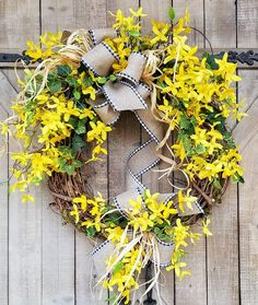 This beautiful burlap forsythia door wreath is the perfect simple accent for your door or interior. A wired burlap ribbon makes a simple bow. Made on 18 grapevine wreath Average Diameter: 25 x 21 (tip to tip) This swag will be created on green floral foam with wire hanger. Indoor/