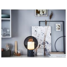 Stunning is the perfect word to describe this ikea table lamp. Modern yet vintage inspired its design is everything we are looking for. Ikea Table Lamp, Uncluttered Living Room, Stylish Storage, Marble Tables Living Room, Table Lamp, Grey Table Lamps, Home Decor, Ikea, Marble Table