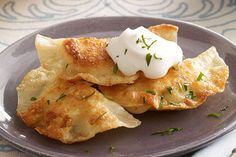 Discover this tasty Shortcut Pierogi Recipe. Mashed potatoes and seasoned cream cheese spread make a delicious stuffing for these easy shortcut pierogis.