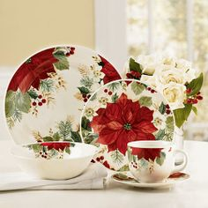 Holiday Grace Dinnerware|The Paragon.  Set on a white table cloth with a Poinsetta center piece  Christmas is served.   Purchase option:  Pair with Lenox Holiday China