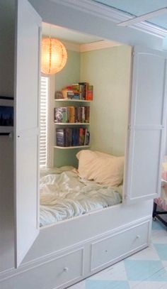 Innovative closet conceals a mini bedroom, complete with bookshelves. My dream house has all sorts of hidden rooms and secret passages. Child at heart...