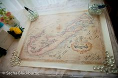 Using a Bermuda map as a guestbook.  Photos by Sacha Blackburne.