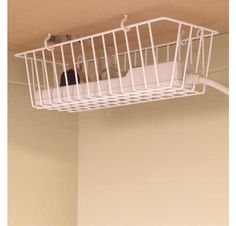 Kitchen basket under desk to hide cords...such simple ideas that I never think of!