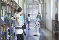 Pepper robot talks to people in a corridor