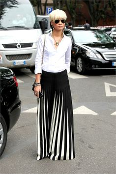 there she is! EstherQueck killing it with white shirt chic and a brilliant skirt. Milan.