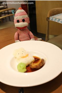 Lil' Squirt plays with his food at Putien, one of Singapore's top 50 restaurants (Shanghai, China)