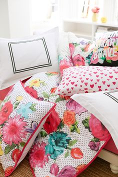 The more pillows the better! Create a mix-and-match look with patterned, neutral and statement-making pillows.