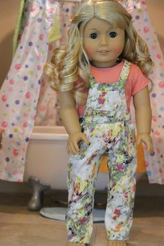 Colorful floral overalls for by MegAGDolls on Etsy. Made using the Oh My Gosh Overalls pattern, found at http://www.pixiefaire.com/products/oh-my-gosh-overalls-18-doll-clothes. #pixiefaire #ohmygoshoveralls