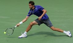 MASON, OH - AUGUST 17:  Marin Cilic of Croatia hits a forehand against Novak Djokovic of Serbia during day seven of the Western & Southern Open at Lindner Family Tennis Center on August 17, 2012 in Mason, Ohio.  (Photo by Nick Laham/Getty Images)