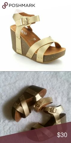 Gold wedge sandals Never worn.  Faux leather upper and rubber sole. Heel height 3 inches Shoes Wedges