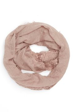 A soft rose colored infinity scarf