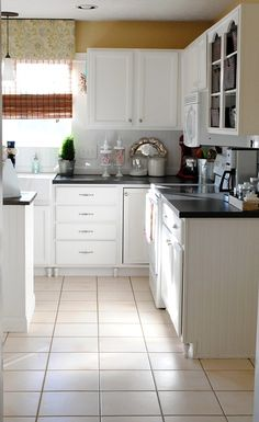 DIY kitchen makeover love the legs and the black counters with white cabinets :)