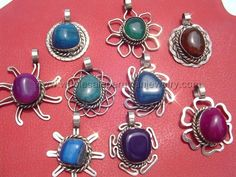 Assorted Agate Pendants. Click the link to purchase our unique handmade Peruvian jewelry at awesome wholesale prices (includes shipping & insurance!)  Make money with your own online or offline business selling Peruvian Jewelry or save big on beautiful gifts for yourself or that special someone! Click here:  http://www.wholesaleperuvianjewelry.com/