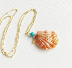 Rare orange color sunrise shell beautifully hand wrapped with round turquoise bead in 14k gold filled wire suspended from a delicate gold filled cable chain and finished with gold filled spring ring c