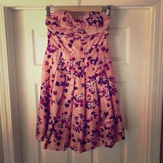 Express Floral Print Corset Dress Pink, purple and ivory floral print dress by Express. A bustier bodice with boning and a gathered sweetheart neckline tops a flirty pleated skirt. Comes with matching belt. So perfect for spring! Express Dresses