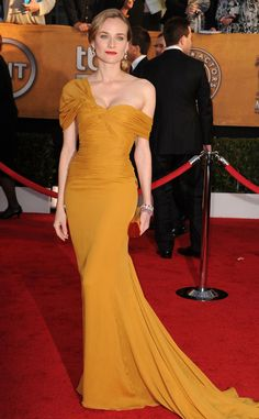 Diane Kruger from Best Dressed Stars Ever at the SAG Awards  Back in 2010, the blond beauty delivered one of the most polarizing SAG Awards looks of all time in a mustard-colored Jason Wu gown with a draped shoulder.
