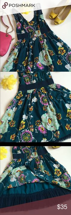 Free people floral dress 100% polyester. 33 inches long, 32 inch bust, elastic waist Free People Dresses