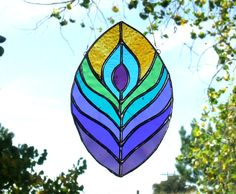 Stained Glass Peacock Feather Suncatcher by LadybugStainedGlass