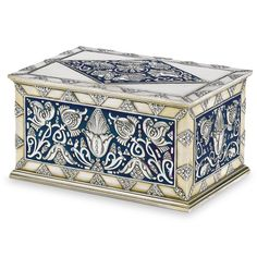 A Fabergé silver-gilt and enamel table cigar box, Moscow, 1908-1917, rectangular, the cover and the sides all similarly decorated with finely cast and chased Art Nouveau floral designs against an opaque royal blue enamel ground.