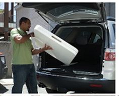 Lifetime Folding Table 80174 6-Foot Almond Fold-in-Half Table. This picture shows a man putting the table in his car.