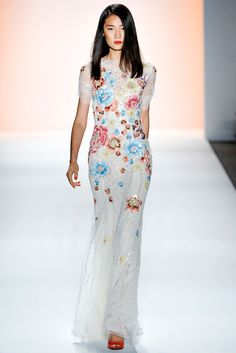 Jenny Packham S/S RTW 2012: What an exquisite dress! The colorful embellished flower design with the embroidered lace sleeves is feminine.