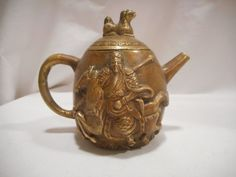 """This tea pot was purchased in San Francisco in the mid 1990s. Solid brass. Measures 4 1/4"""" high and 5"""" wide. Beautiful condition. Displayed in a smoke-free home. 