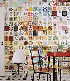 I was thinking of something like this, except patches of tiles, rather than entirely covered, for our retaining wall. The rest would be white plaster. Partly inspired by Parc Guel, partly by a friend putting 4 or 5 handpainted tiles on her garden wall.