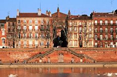 """Toulouse is known as """"la ville rose"""" — the pink city — because so many of its buildings were built out of brick, including the one where we lived."""