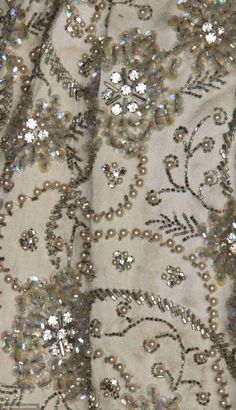 Detail of the dress of Mrs. Nat King Cole, white silk satin covered in silver sequins, irridescent crystal beads, rhinestones and pearls.