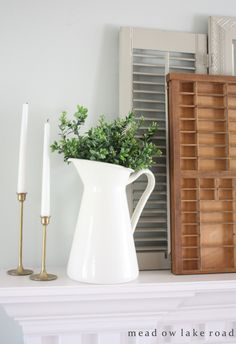 Mix of vintage elements with greenery to create a spring look on the mantel | wwww.meadowlakeroad.com