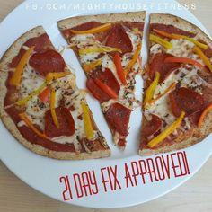 """21 Day Fix Pizza  1 """"Flatout"""" flatbread Organic tomato sauce 3 veggies of your choice Mozerella cheese Nitrite free turkey pepperoni Dry or fresh basil *Preheated oven to 350 *Place flatout on cookie sheet lightly sprayed with organic olive oil cooking spray. *Cook flatbread alone for 2-3 minutes. *Remove from oven and cover flatbread with a few spoonfuls of tomato sauce, 1 blue container of cheese and the other toppings."""