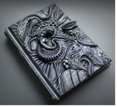 Dark journal cover by Aniko Kolesnikova, designed using hand tooled polymer sculpture techniques, as seen on The Polymer Arts magazine's blog: www.thepolymerarts.com.