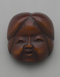 Wooden mask of Otafuku. Japan. Probably 19th century Netsuke, wood