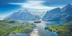 Although in the Arctic Circle, the Lofoten Islands are warmer than expected due to warm air brought by the Gulf Stream; some never dip below freezing. Hurtigruten in Trollfjorden