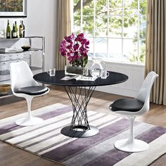 Noguchi Cyclone table with Saarinen Tulip chairs... a match made in heaven!