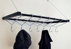 Modern twist for an outdated hanger.  See other great ideas here: http://www.core77.com/blog/furniture_design/things_that_look_like_other_things_that_weve_posted_the_hang-over_by_labyrinth_products_21704.asp
