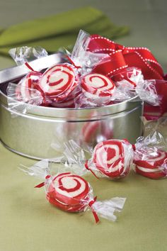 Peppermint Pinwheel Cookies - Giftworthy Christmas Candy - Southernliving. Recipe: Peppermint Pinwheel Cookies  Fill inexpensive metal containers from crafts stores with Peppermint Pinwheel Cookies for a gift your neighbors and friends will love.  Video: Peppermint Pinwheel Cookies