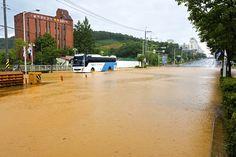 Cheongju, South Korea - July 16, 2017: A bus that runs on flooded roads due to heavy rain