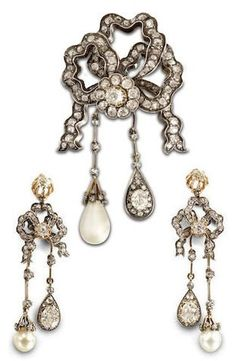 A 19th century natural pearl and diamond brooch and earring suite. The triple bow surmount with fluttering ends set throughout with old brilliant-cut and cushion-shaped diamonds, suspending two pendants of unequal length, both set with rose-cut diamonds on knife-wire connectors, one with a large natural pearl drop, the other with an oval-cut diamond within a pear-shaped surround of old brilliant-cut diamonds, mounted in silver and gold, the earrings en suite. #Antique #parure