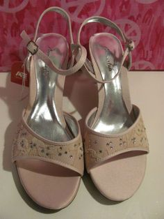 AMERICAN EAGLE    WOMENS PINK    LACE AND BLING    STRAPPY HEELS    BRAND NEW WITH TAGS    SIZE 7M    3 IN HEEL    PINK BLING    BUCKLES AT THE ANKLE    SUPER CUTE AND CLASSY HEEL    SILVER LIGHTLY PADDED INSOLE    WONDERFUL ADDITION TO    YOUR WARDROBE