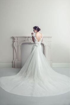 Harmonia - wedding gown with a detachable long train. It can also be used as a veil. White on White bridal