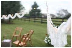 backyard garden party, wooden chairs, white tulle, strung lights,