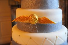 Golden Snitch cake, made by Nicola Bottomley. From Sorrel & Andy's Harry Potter Wedding. Sorrel owns and runs Ambience Venue Styling North  Lancashire.
