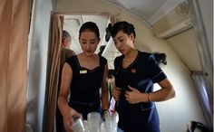 Air Koryo, a North Korea carrier on the Ilyushin II-18, a plane that had its first flight in 1957. Flight attendants serving with plastic cups.  photo by passenger Aram Pan in a travel organised by Juche Travel.